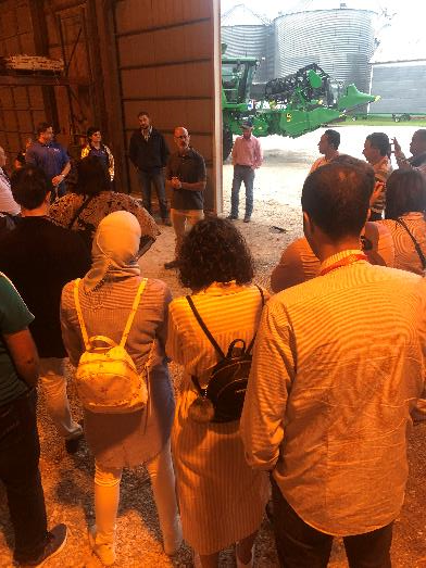 One highlight of the 2019 U.S. Soy Global Trade Exchange was the first day of industry and farm tours. On Aug. 20, more than 300 conference participants loaded nine buses in downtown Chicago and spent the day seeing the Illinois soybean industry in action. Visits included Jeff O'Connor's farm near Kankakee, Illinois. Despite some rain, no farm tour is complete without a combine on display.